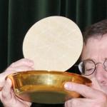 Bishop Holding Host Aloft