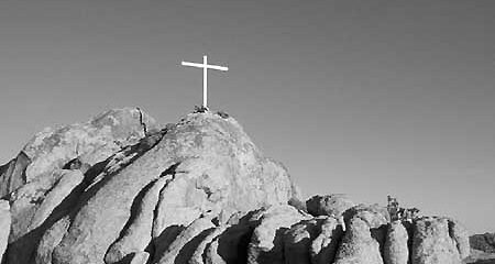 Cross Atop Rocky Cliff