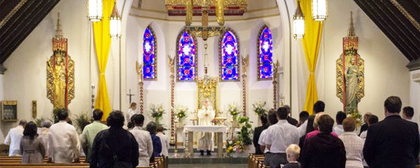 File Photo of Mass Underway Inside Church, adapted from image at army.mil