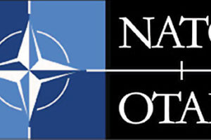 NATO logo and acronym in English in French