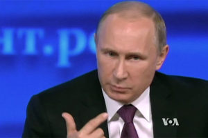 File Photo of Vladimir Putin Gesturing, with VOA Logo