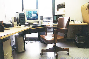 File Photo of Empty Desk with Computer Work Station, apdapted from image at osha.gov