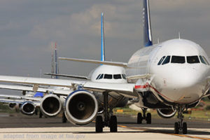 File Photo of Jets Waiting in Line at Airport, adapted from image at faa.gov