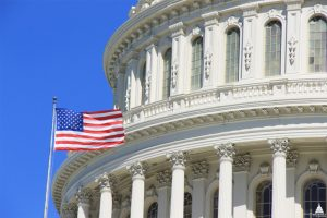 File Photo of Portion of U.S. Capitol Dome and U.S. Flag, adopted from .gov image by Steven C. Welsh
